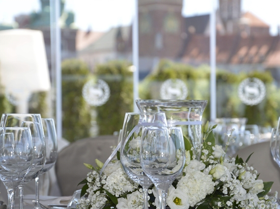 Glasses and flowers on table